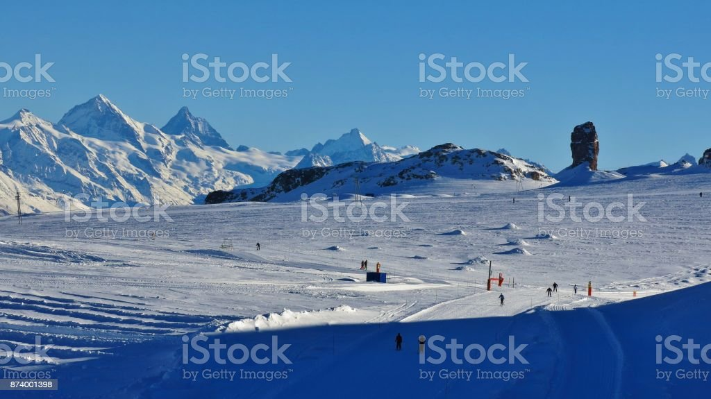 Ski slopes on the Diablerets glacier. Famous rock Quille du Diable. Winter scene in Switzerland. stock photo