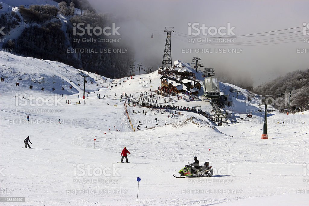 Ski station CERRO CATEDRAL above the clouds (Closer Horizontal composition) royalty-free stock photo