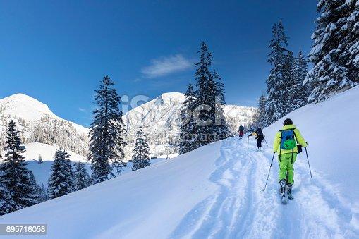 istock Ski Touring - Freerider at the way to Summit - Mount Sonntagshorn 895716058