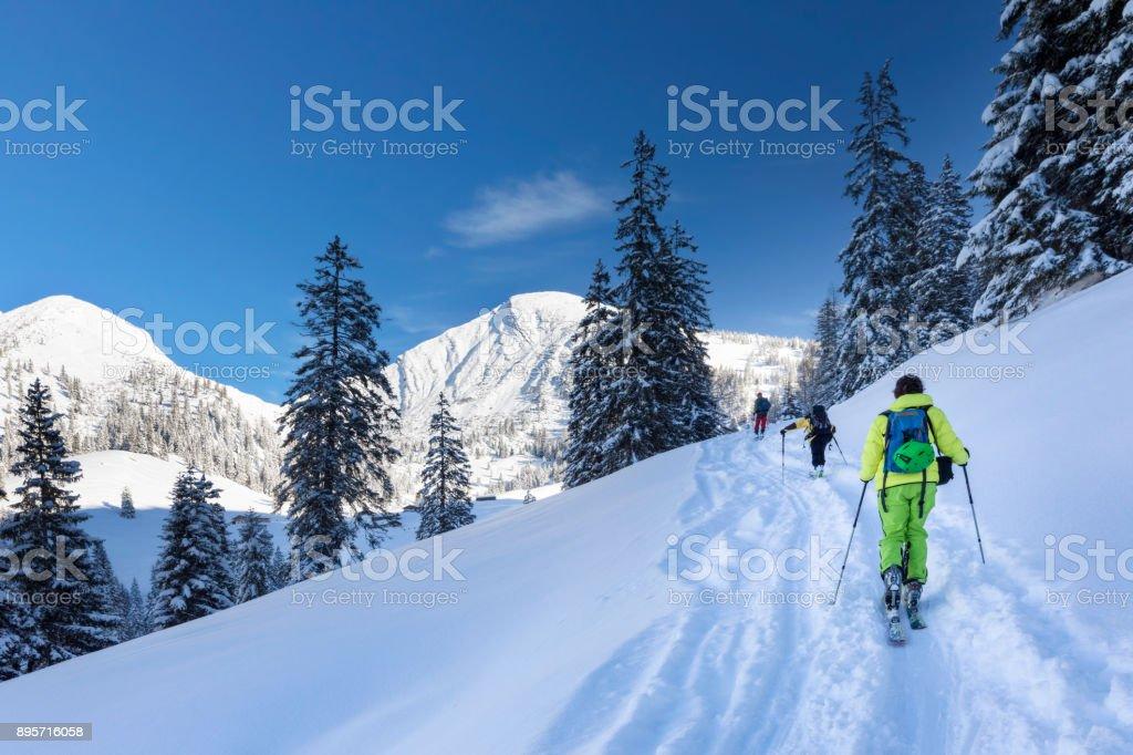 Ski Touring - Freerider at the way to Summit - Mount Sonntagshorn stock photo
