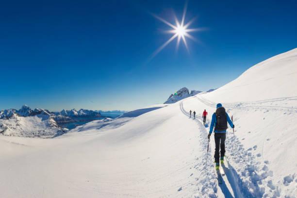 Ski touring in the eternal ice,  Lofoten - Norway stock photo