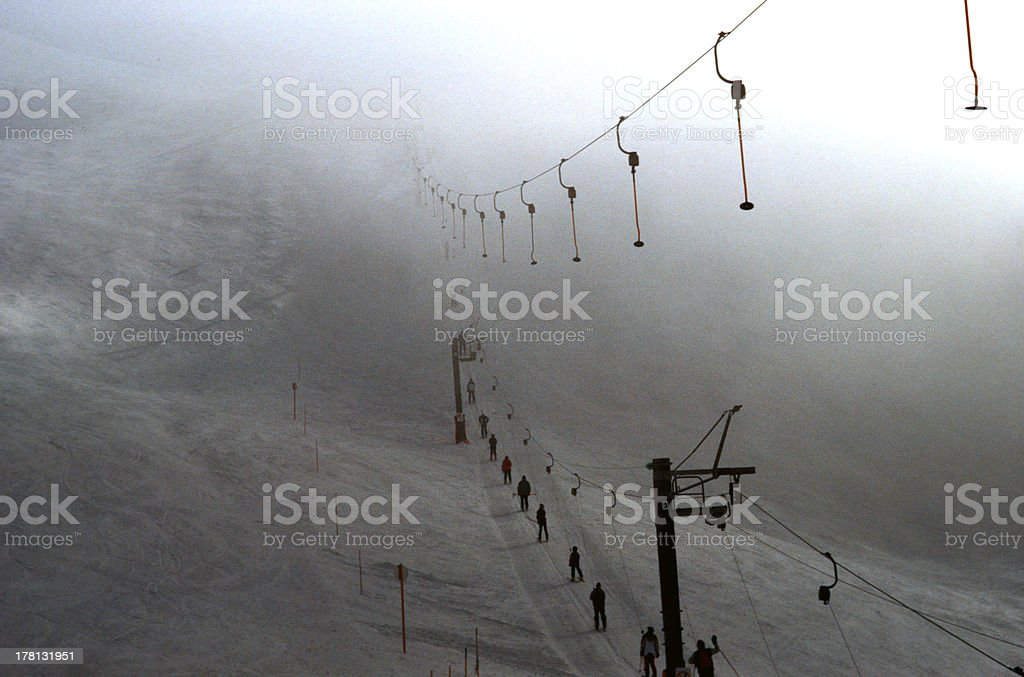 Ski tow and skiers royalty-free stock photo