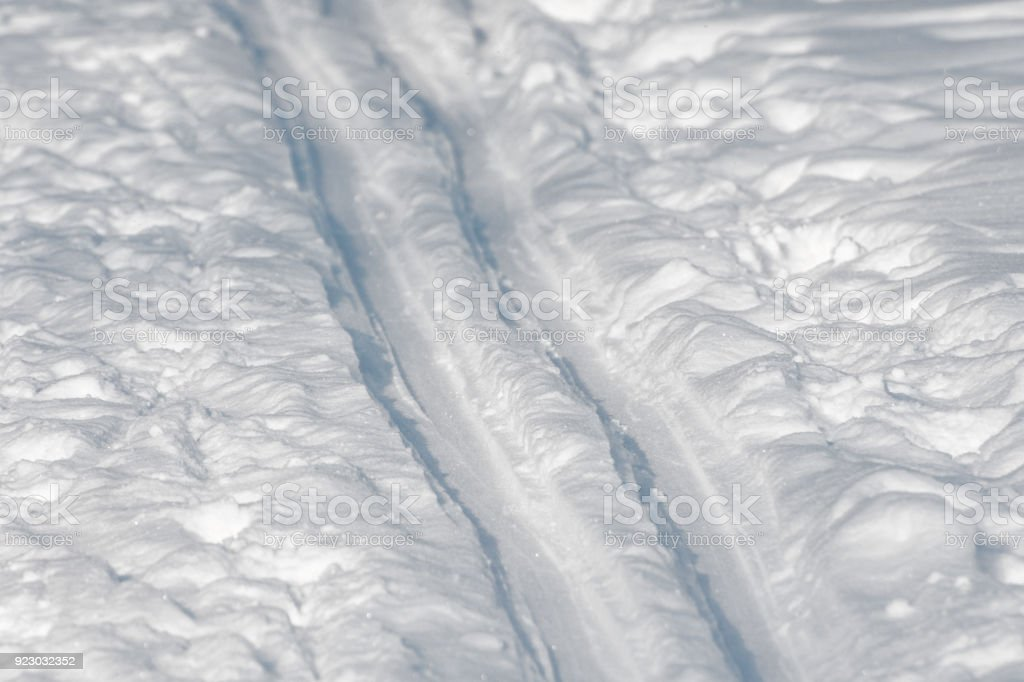 Ski track close-up on white snow in winter on a clear sunny day. stock photo