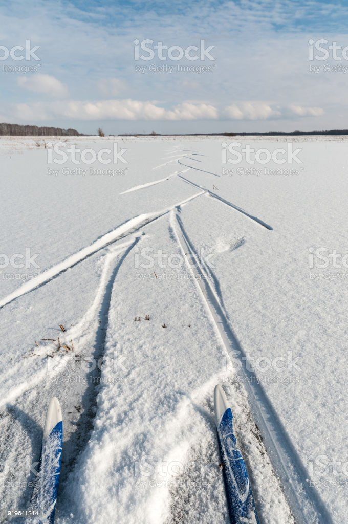 Ski track in the field on a Sunny day. stock photo