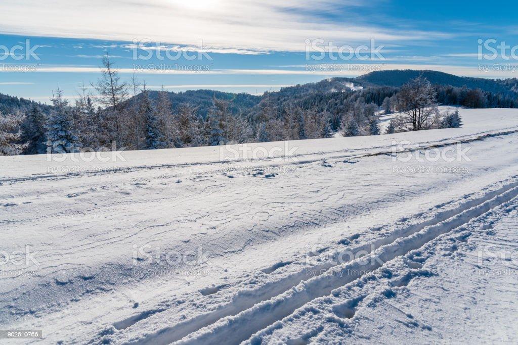Ski track in winter landscape of Beskid Sadecki Mountains on sunny day, Poland stock photo
