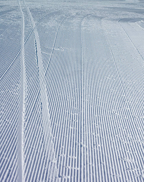 ski tracks on fresh corduroy - deviate stock pictures, royalty-free photos & images