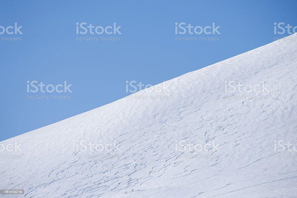 Ski trails on a mountainside royalty-free stock photo