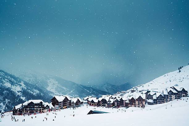 ski village on a snowy day - village stock photos and pictures