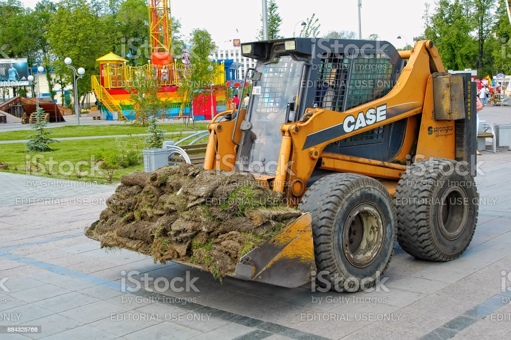 Skid loader for gardening works stock photo