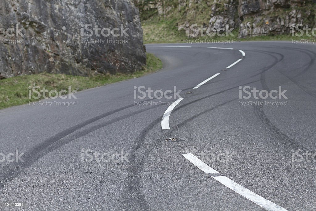 Skid marks left by bored teen drivers royalty-free stock photo