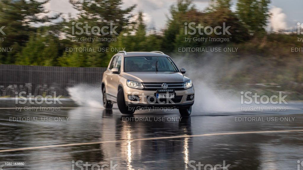 SUV skidds on a slippery wet road. stock photo