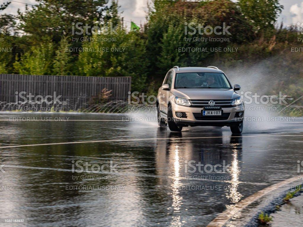 SUV skidds slippery wet road. stock photo