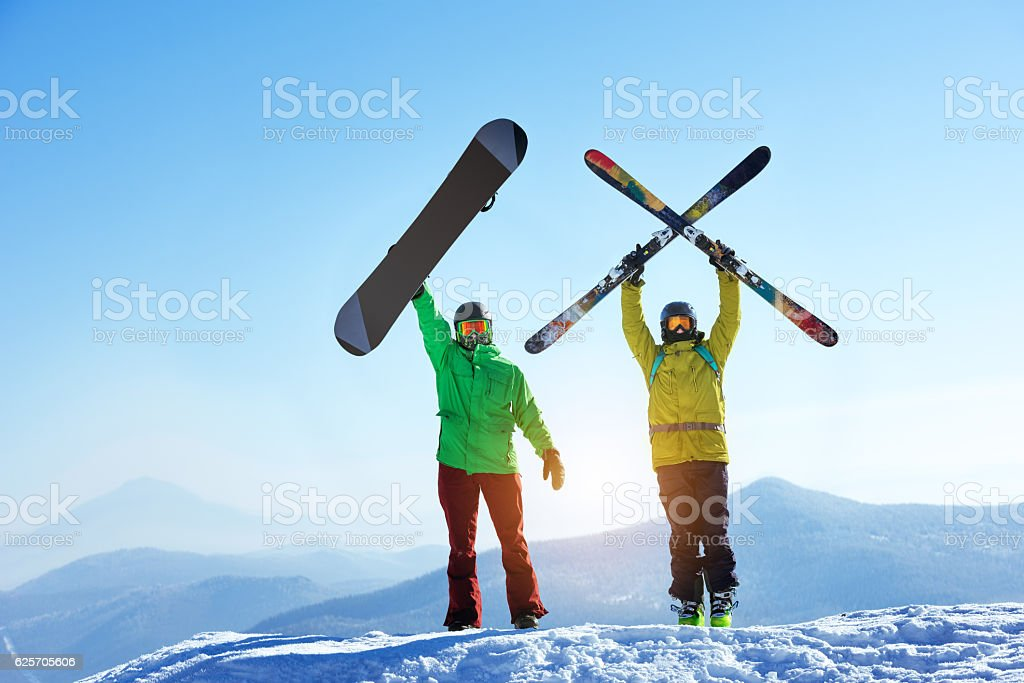 Skier and snowboarder mountain top stock photo