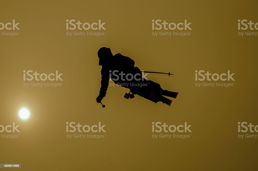 Skier and sun stock photo