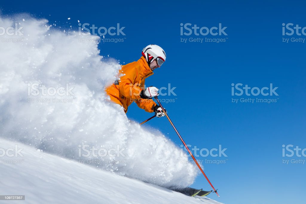 skier appearing out of snow cloud royalty-free stock photo