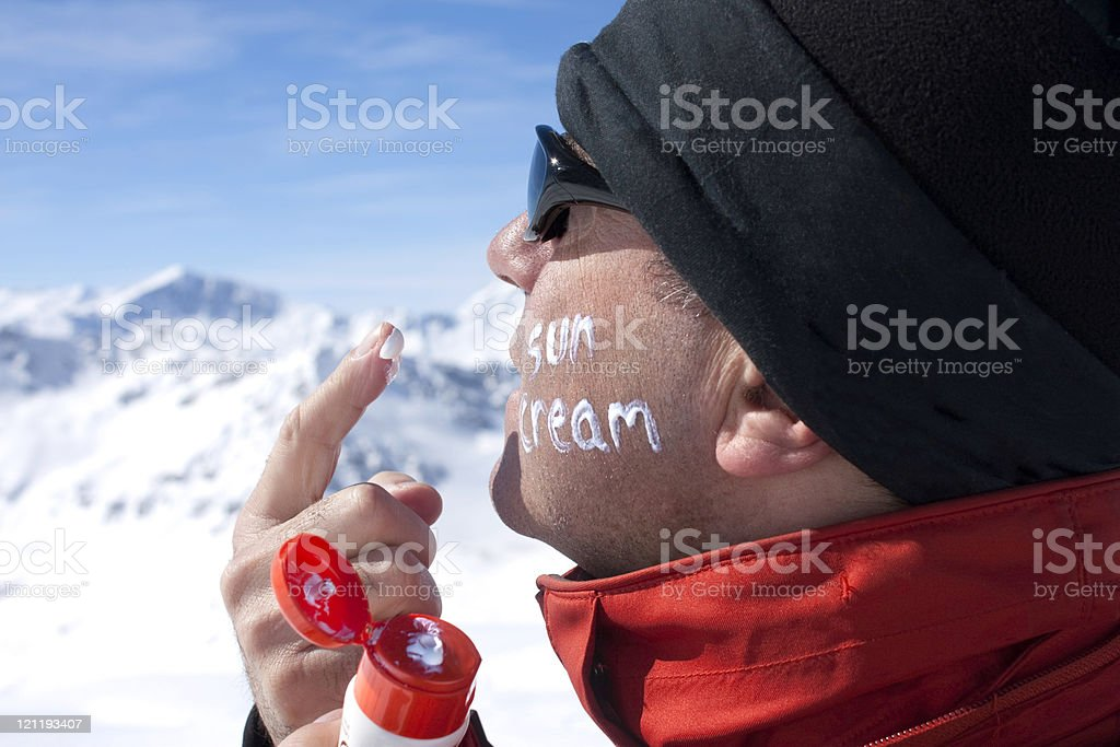 Skier applying sun block stock photo