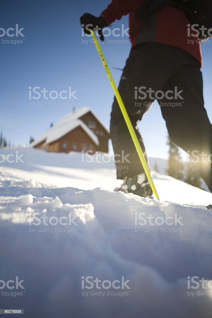 A skier approaches a hut. royalty-free stock photo