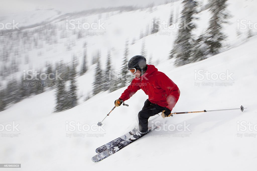 Skier at speed on a downhill run. stock photo
