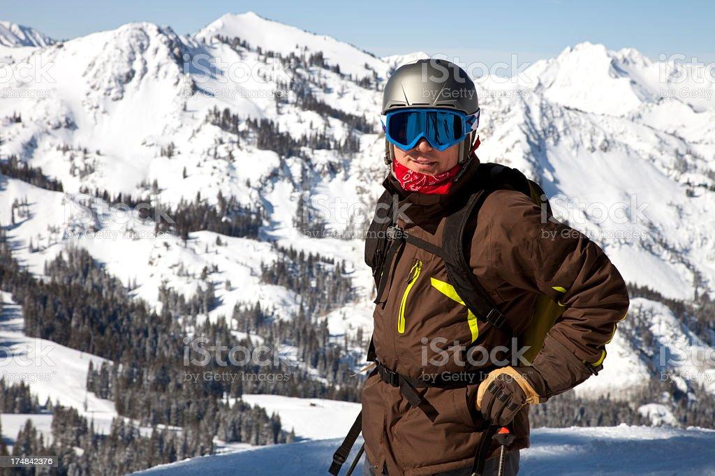 Skier at summit of mountain in Utah looking at camera stock photo