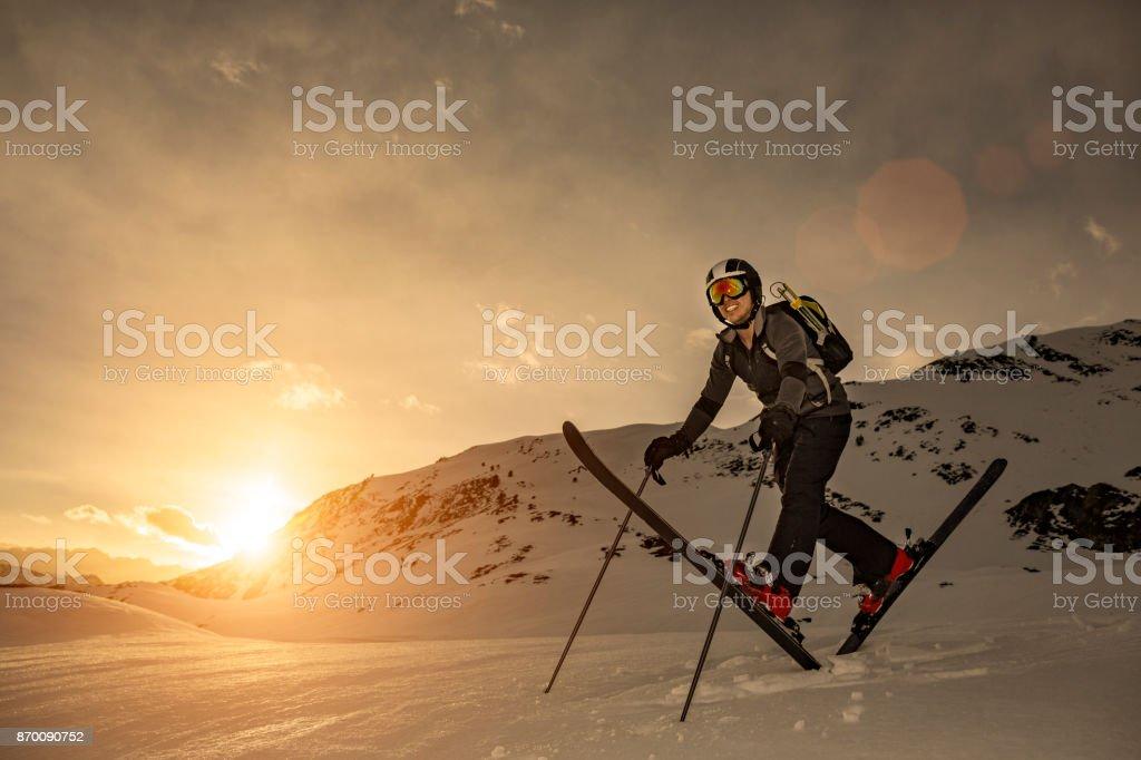 Skier at sunset stock photo