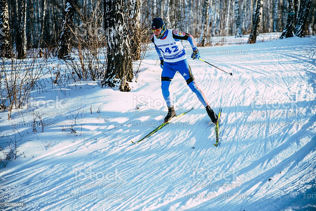 skier athlete winter birch forest sprint race in classic style stock photo