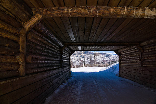 Skier Bridge Tunnel at Beaver Creek Bachelor Gulch Skier Bridge Tunnel at Beaver Creek Bachelor Gulch - Skier bridge with road crossing over. beaver creek colorado stock pictures, royalty-free photos & images