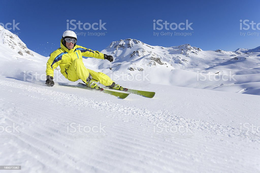 skier carving on slope stock photo