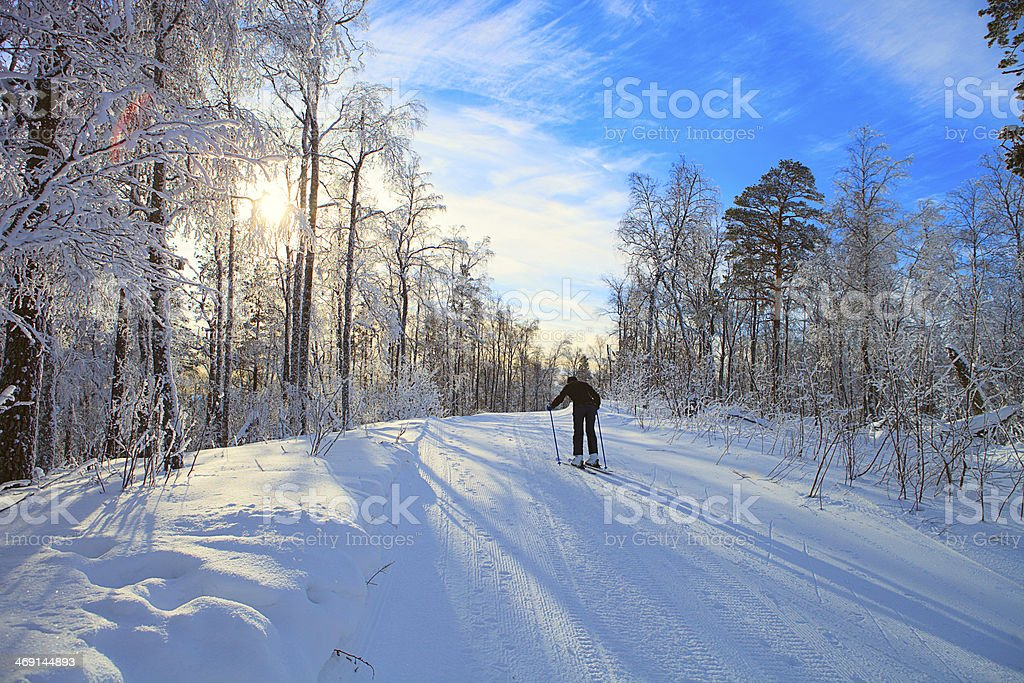 Skier climbs up the piste stock photo