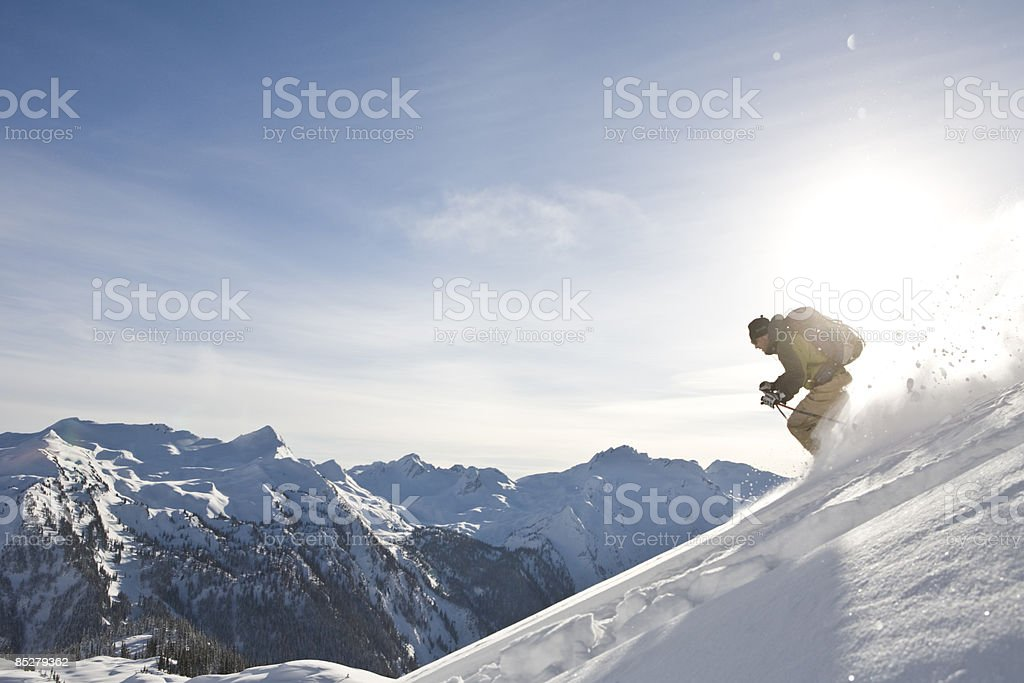 A skier descends. royalty-free stock photo
