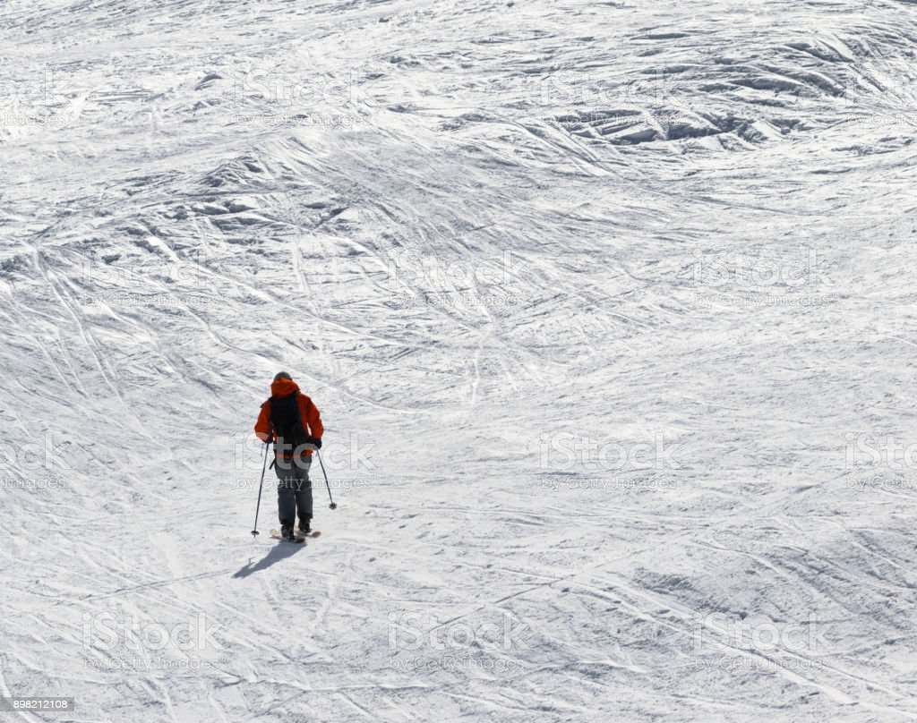 Skier downhill on snowy off-piste slope stock photo
