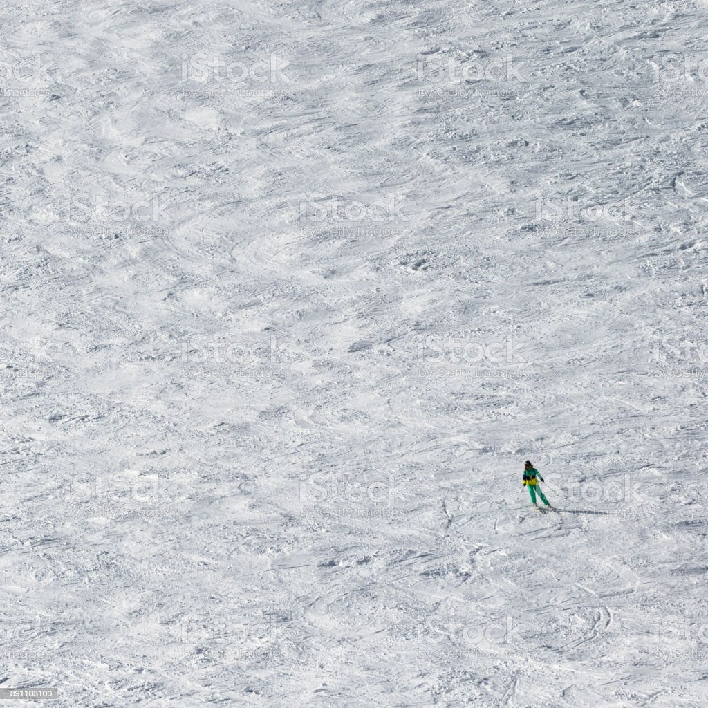 Skier downhill on snowy slope stock photo