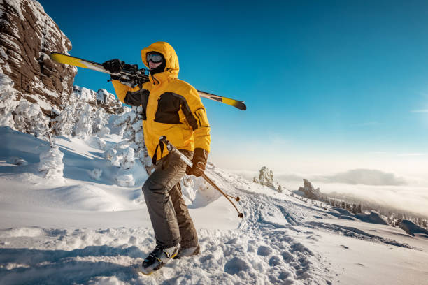 Skier goes uphill backcountry concept