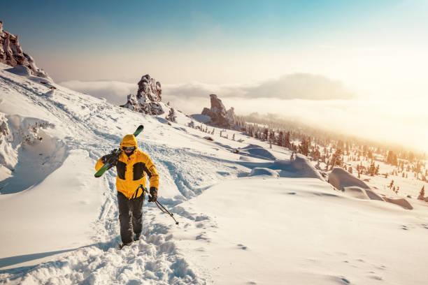 Skier goes uphill in ski tour
