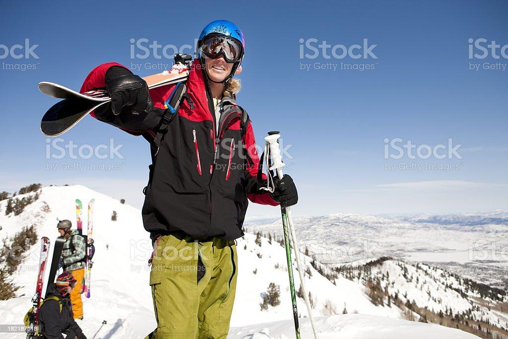 Skier Hiking Mountain Ridge with Friends royalty-free stock photo