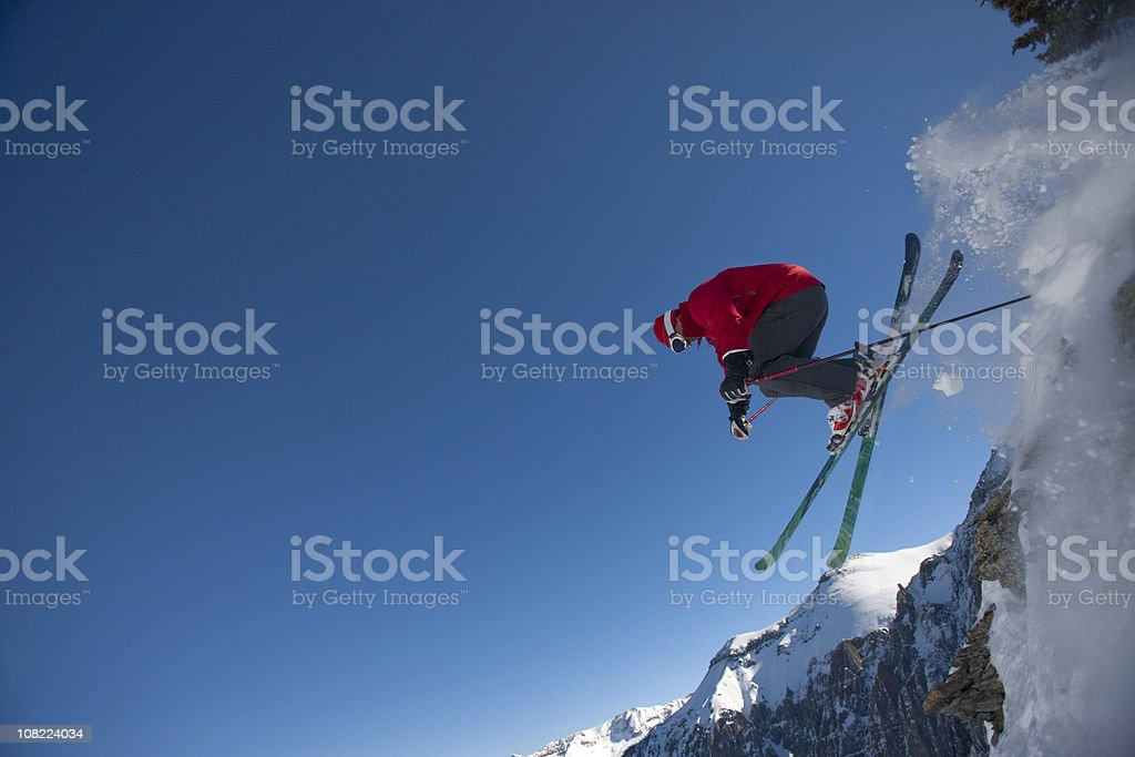 Skier in air jumping off cliff royalty-free stock photo
