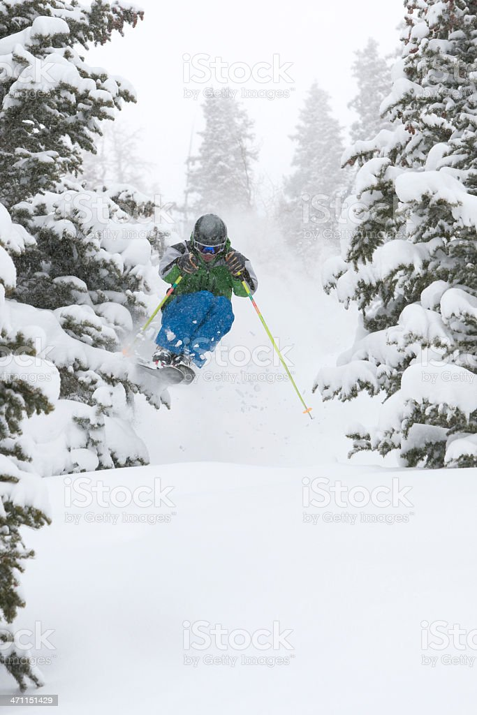 Skier in air on a powder day stock photo