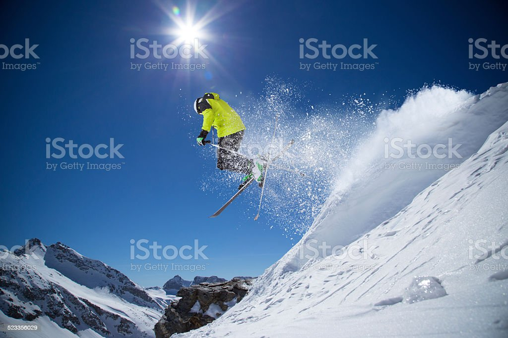 Skier in high mountains stock photo