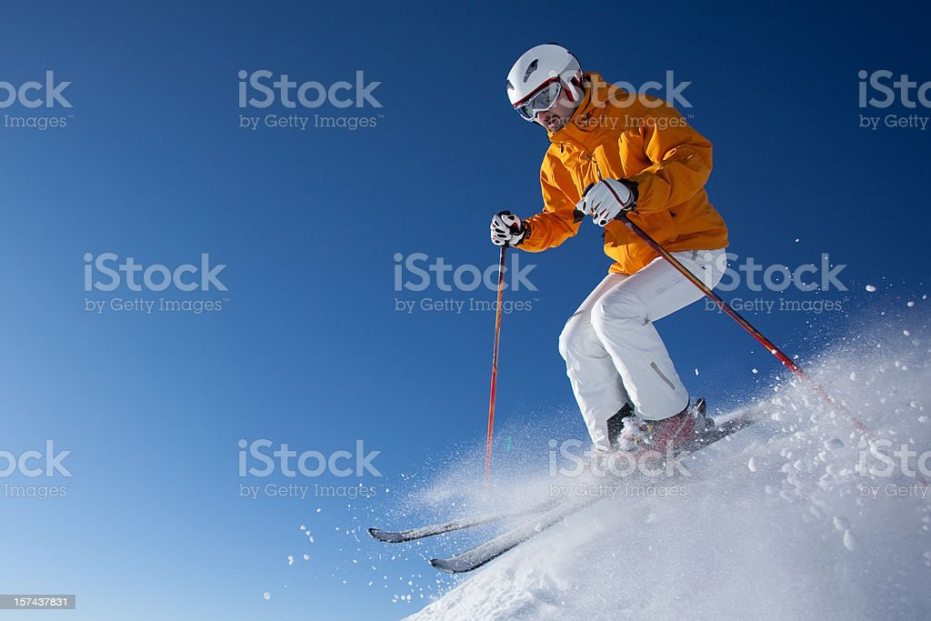 skier in powder snow at blue sky royalty-free stock photo