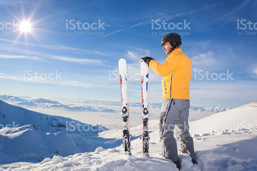 Skier in snowy mountains stock photo