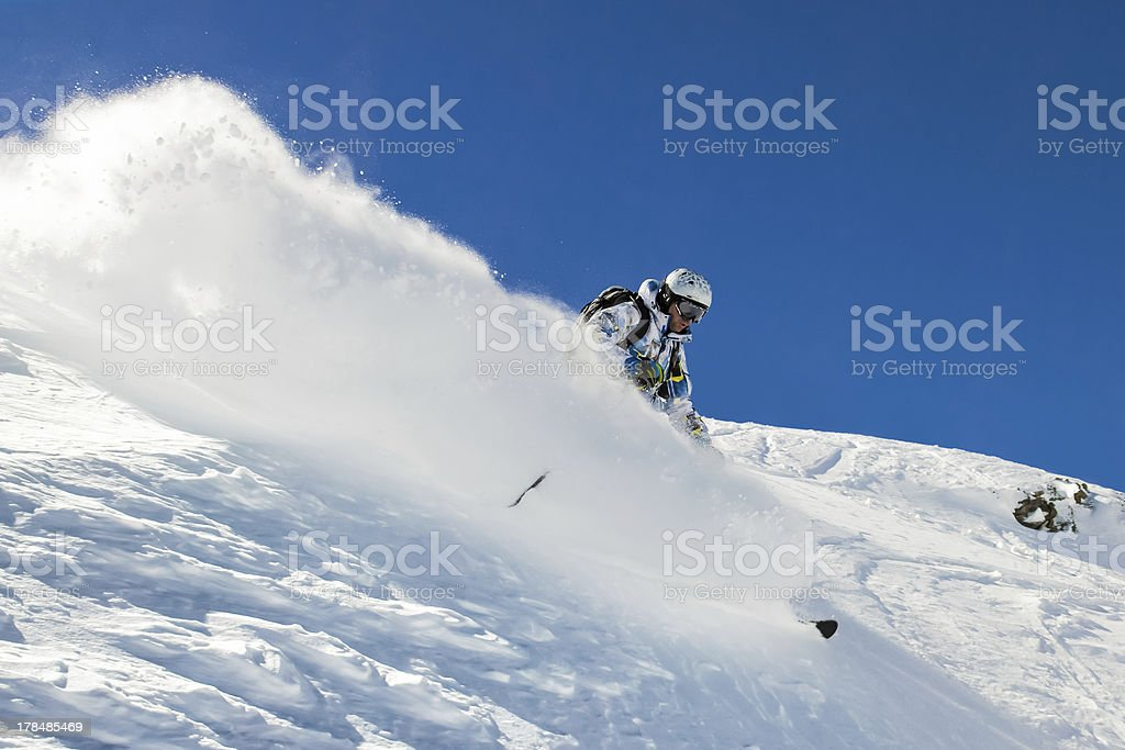 Skier in soft snow stock photo