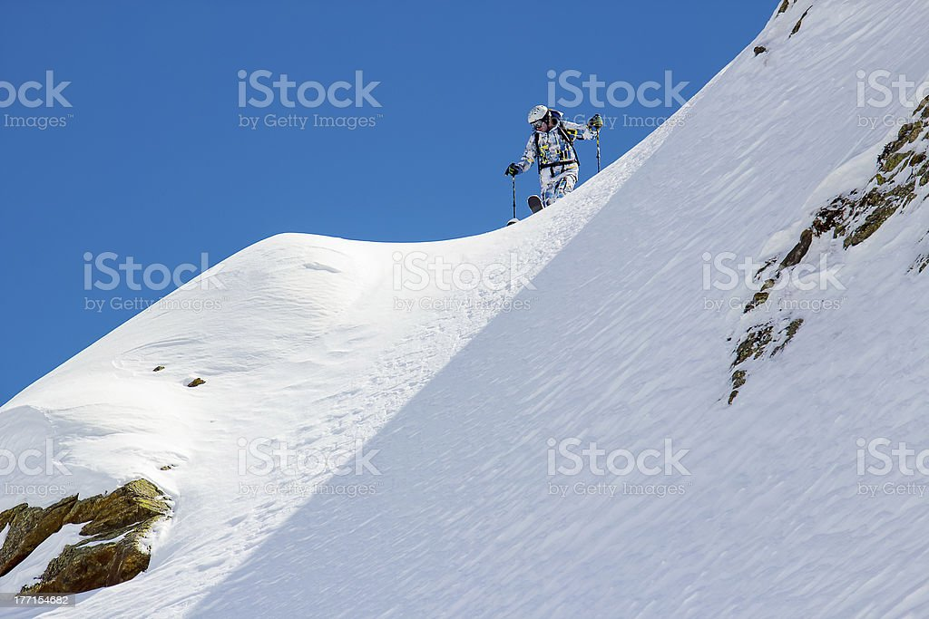 Skier in the mountains royalty-free stock photo