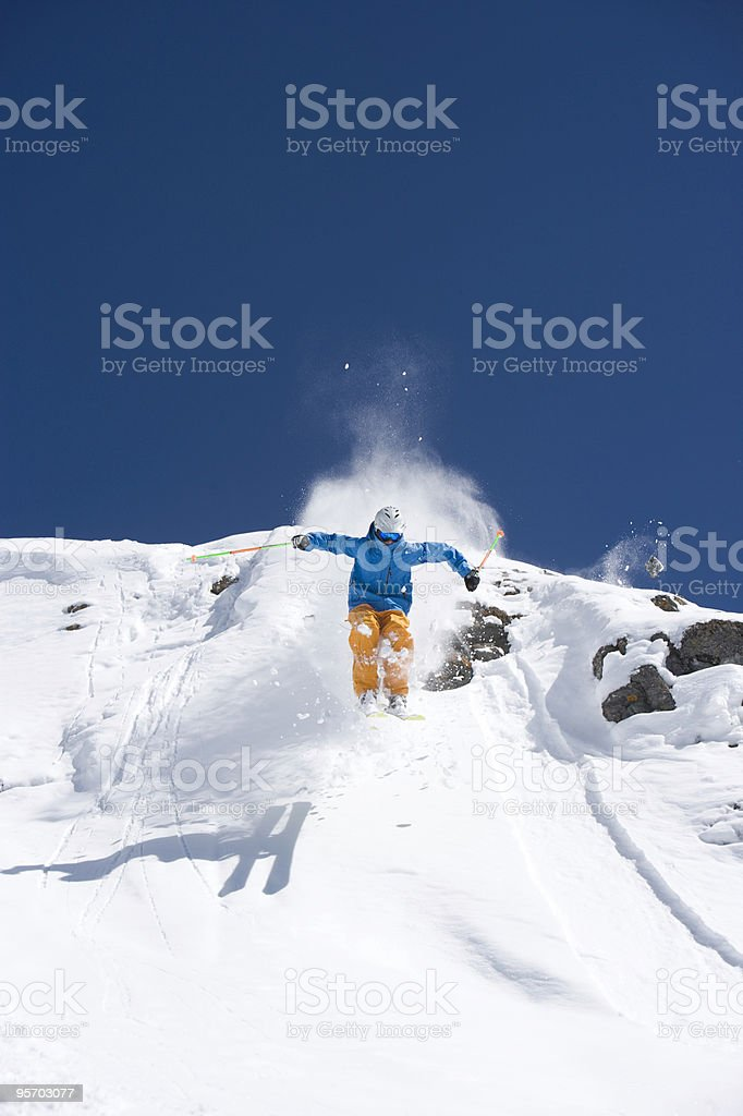 Skier jumping from cliff royalty-free stock photo
