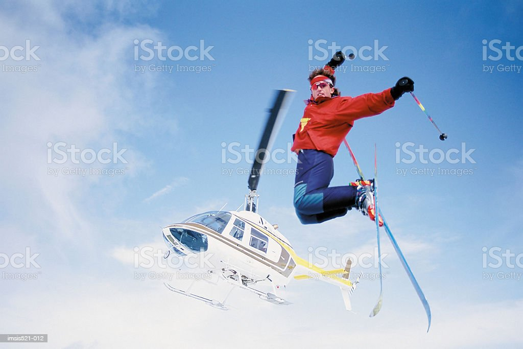 Skier jumping from helicopter royalty-free 스톡 사진