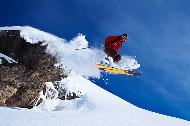 Skier jumping on snowy slope  ski stock pictures, royalty-free photos & images