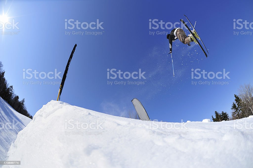 Skier  launching over a jump in terrain park royalty-free stock photo