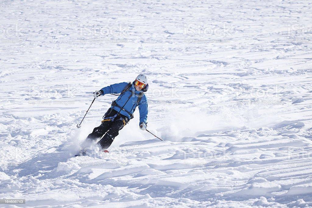 Skier making big carving turn in powder snow royalty-free stock photo