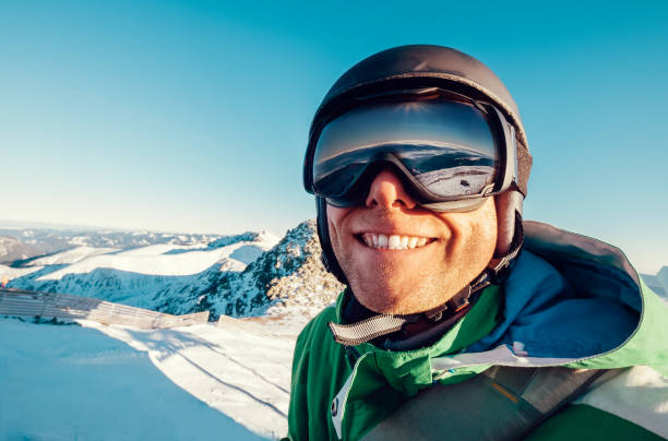 Skier man portrait in safe ski equipment Skier man portrait in safe ski equipment ski goggles stock pictures, royalty-free photos & images
