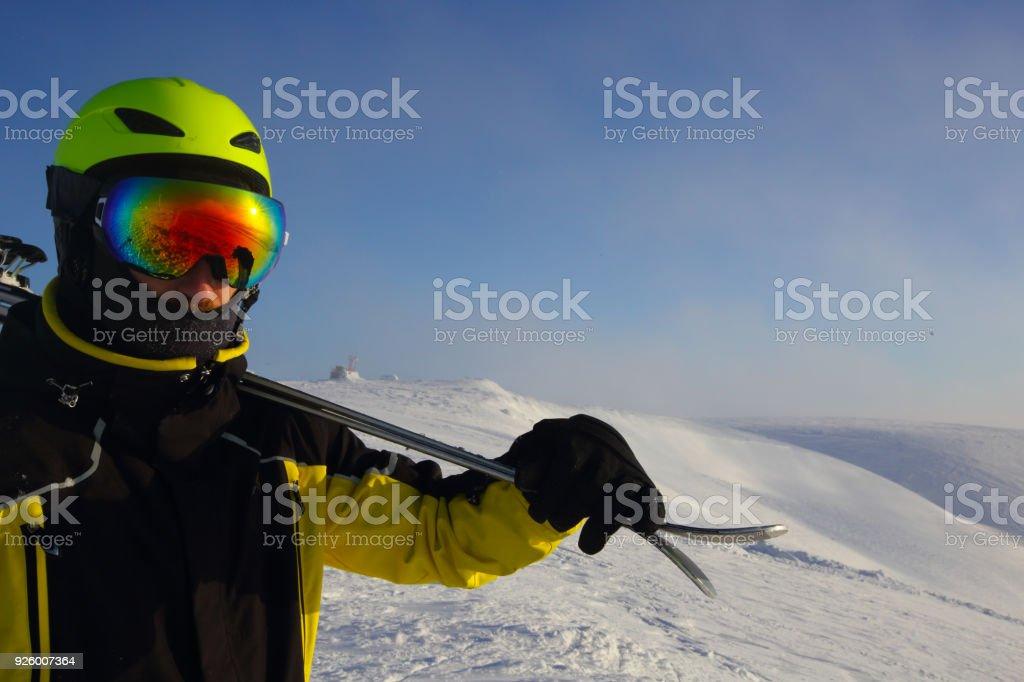 skier on a peak stock photo