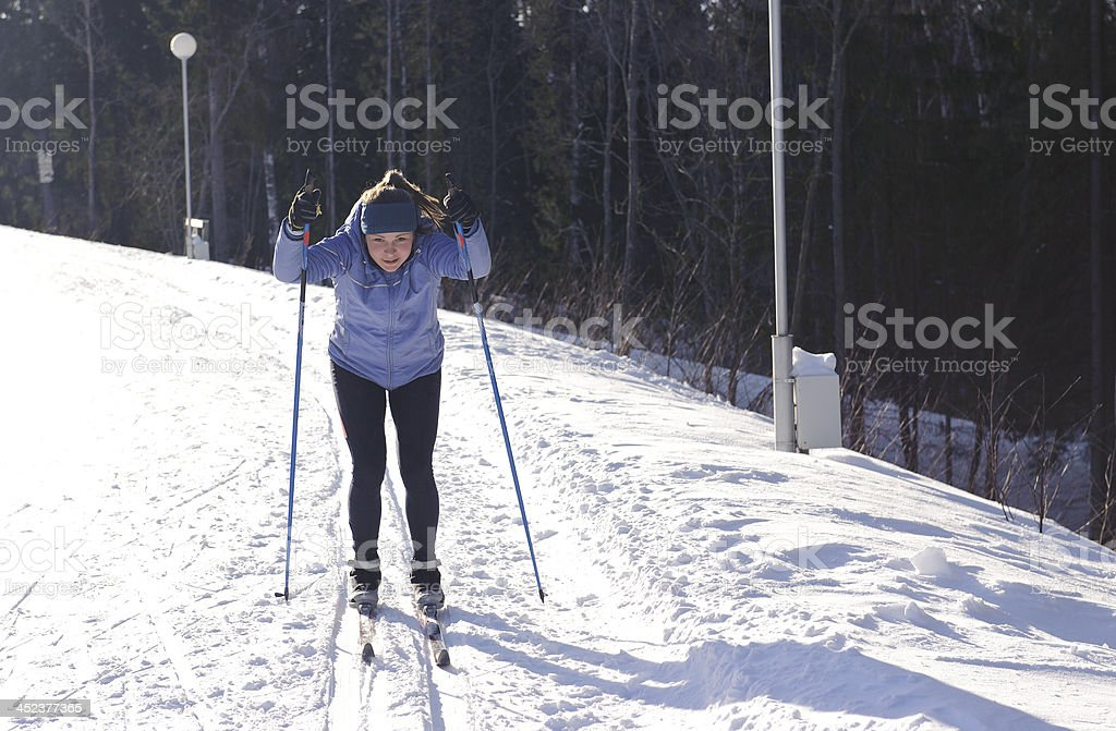 Skier on a walk in the park royalty-free stock photo