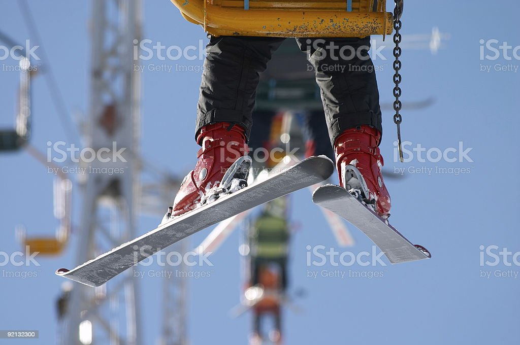 skier on chair lift royalty-free stock photo